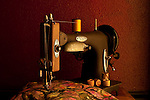 Antique sewing machine with spools and thread and fabric