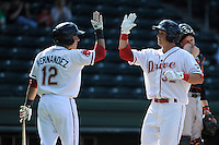 Third baseman Kevin Mager (32) of the Greenville Drive, right, is congratulated by Jayson Hernandez (12) after hitting his first professional home run in a game against the Delmarva Shorebirds on Monday, April 29, 2013, at Fluor Field at the West End in Greenville, South Carolina. Delmarva won, 6-5 in game one of a doubleheader. (Tom Priddy/Four Seam Images)
