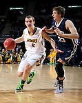 SIOUX FALLS, SD - MARCH 9: Paul Miller #2 of NDSU dribbles past Darian Harris #33 of Oral Roberts  in the first half of their semi-final round Summit League Championship Tournament game Monday evening at the Denny Sanford Premier Center in Sioux Falls, SD. (Photo by Dave Eggen/Inertia)