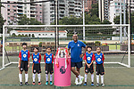 Mark Bright and Hong Kong children pose for a group photo with the Premier League Asia Trophy in front of the Hong Kong skyline for the launch of the Premier League Asia Trophy 2017 at the Hong Kong Football Club on 01 June 2017 in Hong Kong, China. Photo by Chris Wong / Power Sport Images