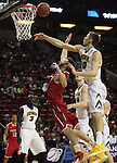 Iowa's Mike Gesell (10) knocks the ball away from Davidson's Tyler Kalinoski (4) during the 2015 NCAA Division I Men's Basketball Championship's March 20, 2015 at the Key Arena in Seattle, Washington.  Iowa beat Davidson 83-52.    ©2015. Jim Bryant Photo. ALL RIGHTS RESERVED.