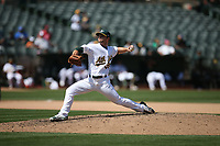 OAKLAND, CA - AUGUST 16:  Daniel Coulombe #35 of the Oakland Athletics pitches against the Kansas City Royals during the game at the Oakland Coliseum on Wednesday, August 16, 2017 in Oakland, California. (Photo by Brad Mangin)