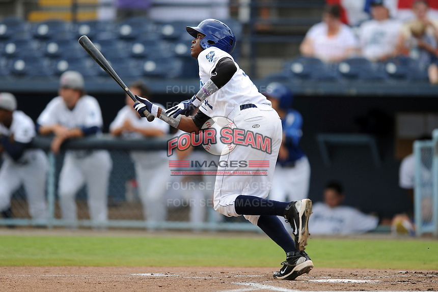 Asheville Tourists shortstop Rosell Herrera #7 swings at a pitch during game one of a double header against the Greensboro Grasshoppers on July 2, 2013 in Asheville, North Carolina.  The Tourists won the game 5-3. (Tony Farlow/Four Seam Images)