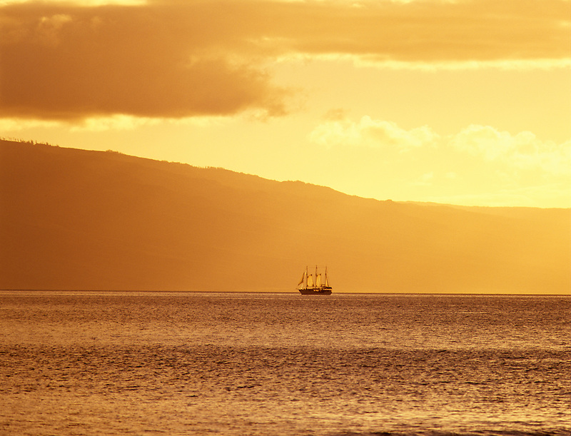 Old time ship with Lanai in background. Maui, Hawaii.
