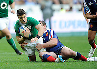 15th March 2014; Conor Murray, Ireland, is tackled by Louis Picamoles, France. RBS Six Nations, France v Ireland, Stade de France, St Denis, Paris. Picture credit: Tommy Grealy/actionshots.ie.