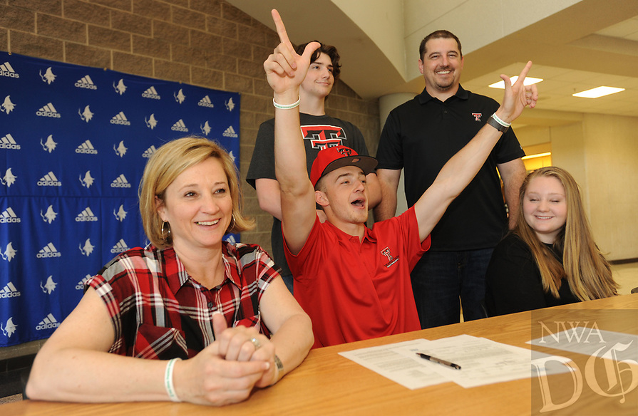 NWA Democrat-Gazette/ANDY SHUPE<br /> Jake Benninghoff (center) celebrates Wednesday, April 12, 2017, alongside his mother, Kim (from left); brother, Drew; father, Joel; and sister, Kate; after signing to jump for the Texas Tech track and field team during a signing ceremony at Rogers High School. Visit nwadg.com/photos to see more photographs from the ceremony.