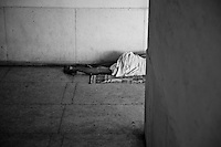 A Tuberculosis patient lies on the floor in a corridor at the Rajan Babu TB hospital in New Delhi, India.