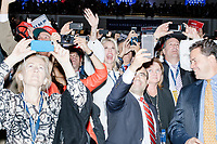 People cheer as President-elect Donald Trump enters the ballroom in the Midtown Hilton at the election night victory rally for Republican presidential nominee Donald Trump, after the presidential race was called for Trump in the early hours of Nov. 9, 2016.