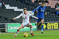 Alex Gilbey of MK Dons under pressure from George Francomb of AFC Wimbledon during the Sky Bet League 1 match between MK Dons and AFC Wimbledon at stadium:mk, Milton Keynes, England on 13 January 2018. Photo by David Horn.