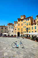 Bicycles in the Piazza dell'Anfiteatro inside the ancinet Roman ampitheatre of Lucca, Tunscany, Italy