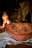 Detail of a traditional hearty French cassoulet straight from the oven