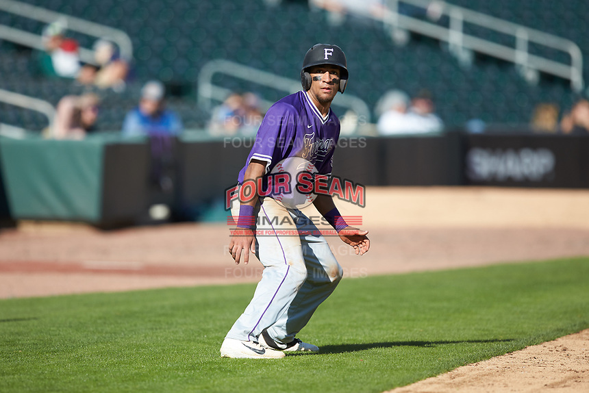 Jordan Starkes (23) of the Furman Paladins takes his lead off of third base against the Wake Forest Demon Deacons at BB&T BallPark on March 2, 2019 in Charlotte, North Carolina. The Demon Deacons defeated the Paladins 13-7. (Brian Westerholt/Four Seam Images)