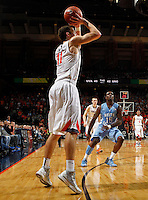 Virginia forward Evan Nolte (11) shoots a three pointer during the game against North Carolina at the John Paul Jones arena in Charlottesville, Va. Virginia defeated North Carolina 61-52.