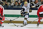 Oct. 21, 2011; Brian Rust (21) passes the puck in the opening Hockey game in the Compton Family Ice Arena. Notre Dame won 5-2...Photo by Matt Cashore/University of Notre Dame