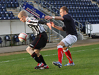 Jack Smith shields the ball from Kyle Turnbull at the Falkirk v St Mirren  Scottish Football Association Youth Cup 4th Round match played at the Falkirk Stadium, Falkirk on 16.12.12. .