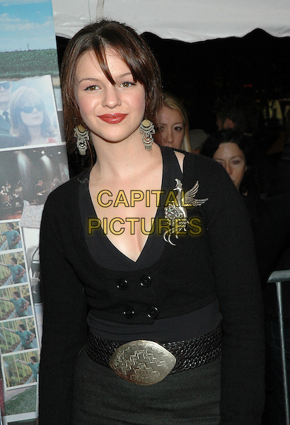 "AMBER TAMBLYN.Premiere of ""Elizabethtown"", at the Loews Lincoln Square Theater in Manhattan, New York, New York ..October 10th, 2005.Photo Credit: Patti Ouderkirk/AdMedia/Capital Pictures.Ref: PO/ADM/CAP.half length black silver belt buckle bird brooch dangling earrings.www.capitalpictures.com.sales@capitalpictures.com.© Capital Pictures."