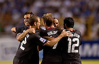 Landon Donovan #10 is congratulated after scoring the winning goal against Honduras. .USA clinches a spot in the  2010 World Cup after defeating Honduras in 3-1 during CONCACAF qualifying in San Pedro Sula, Honduras, October 10, 2009.