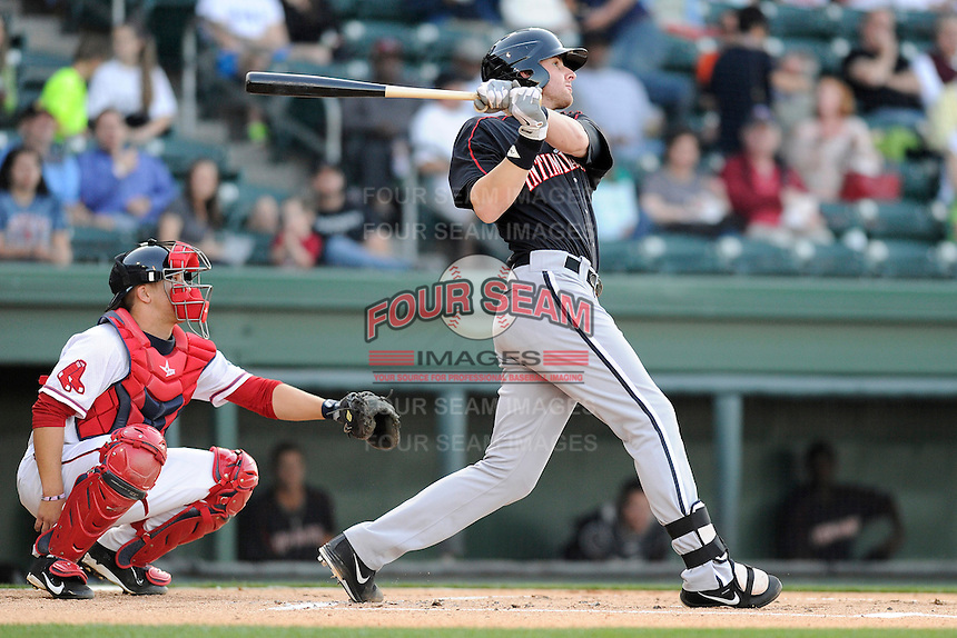 Infielder Danny Hayes (32) of the Kannapolis Intimidators bats in a game against the Greenville Drive on Friday, April 11, 2014, at Fluor Field at the West End in Greenville, South Carolina. The Greenville catcher is Jake Romanski. Greenville won, 13-2. (Tom Priddy/Four Seam Images)