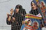 Relatives of four Palestinian men abducted by unidentified masked gunmen on August 19, hold their relatives' pictures during a protest demanding for their return, in front of the Gaza-Egypt border in Rafah in the southern Gaza Strip, on January 11, 2016. Photo by Abed Rahim Khatib