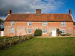 Traditional red brick long farmhouse semi-detached building, Boyton, Suffolk, England
