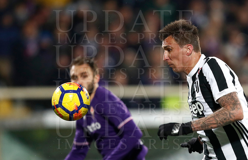 Calcio, Serie A: Fiorentina - Juventus, stadio Artemio Franchi Firenze 9 febbraio 2018.<br /> Juventus' Mario Mandzukic in action during the Italian Serie A football match between Fiorentina and Juventus at Florence's Artemio Franchi stadium, February 9, 2018.<br /> UPDATE IMAGES PRESS/Isabella Bonotto