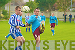 Spa Road's Paul Donovan and Lenamore Rovers Pat Kennelly.
