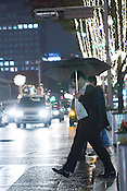 People walking on the streets on a rainy evening in Sakae, Nagoya Japan.