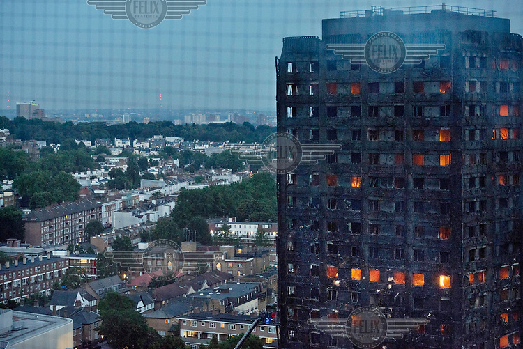 Fires continue to burn inside Grenfell Tower many hours after a devastating fire, that began in early hours of Wednesday, 14 June, swept up the 24 storey building causing the deaths of at least 79 people and leaving many more without homes or possessions.