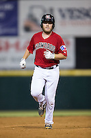 Chuck Moorman (29) of the Hickory Crawdads rounds the bases after hitting a home run against the Charleston RiverDogs at L.P. Frans Stadium on August 25, 2015 in Hickory, North Carolina.  The Crawdads defeated the RiverDogs 7-4.  (Brian Westerholt/Four Seam Images)