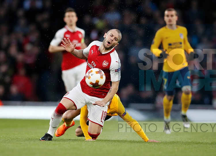 Arsenal's Jack Wilshere gets fouled by Atletico's Sime Vrsaljko who gets booked during the Europa League Semi Final 1st Leg, match at the Emirates Stadium, London. Picture date: 26th April 2018. Picture credit should read: David Klein/Sportimage