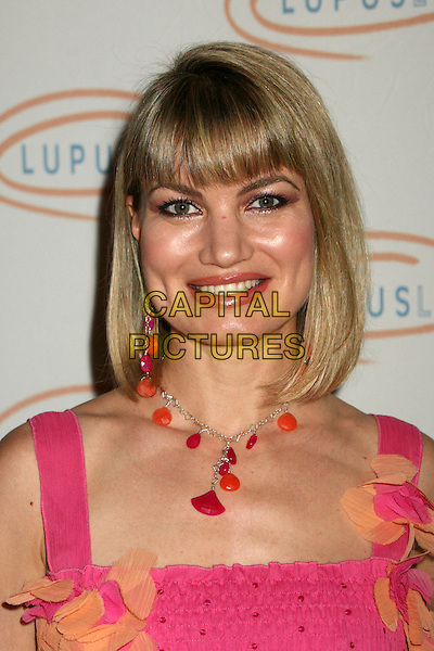 """RENA RIFFEL.Lupus LA's """"Love, Light and Laughter"""" Fundraiser 2007 at the Beverly Hills Hotel, Beverly Hills, California, USA..May 8th, 2007.headshot portrait pink necklace .CAP/ADM/BP.©Byron Purvis/AdMedia/Capital Pictures"""