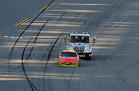 Nov. 1, 2009; Talladega, AL, USA; NASCAR Sprint Cup Series driver Jeff Gordon is pushed by a tow truck to pit road after running out of gas during the Amp Energy 500 at the Talladega Superspeedway. Mandatory Credit: Mark J. Rebilas-