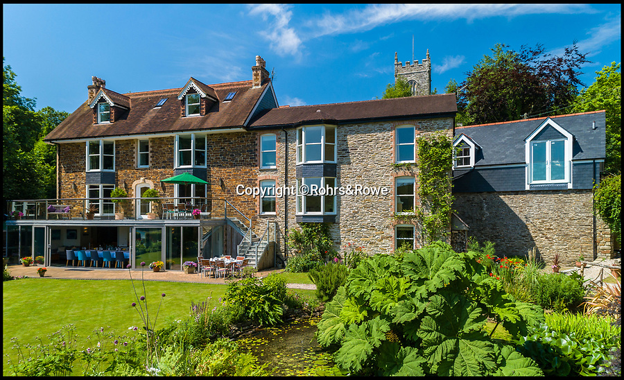 BNPS.co.uk (01202 558833)<br /> Pic: Rohrs&Rowe/BNPS<br /> <br /> Idyllic riverside vicarage in the heart of Cornwall...<br /> <br /> A former vicarage that has been transformed into a stunning riverside home is now on the market for £1.895m.<br /> <br /> The Old Vicarage in the picturesque hamlet of St Clement, Cornwall, is right on the banks of the Tresillian River, a tributary of the River Fal.<br /> <br /> The seven-bedroom property has spectacular views of the river and estate agents Rohrs & Rowe say although it is just a mile from the cathedral city of Truro, the home feels like it's in the heart of the countryside.<br /> <br /> The current owners have run the property, which dates back to the 1500s, as a guesthouse, but it could easily be sold to someone looking for a lifestyle change or run as a business.