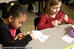 Education Elementary school Grade 2 mathematics two girls working on project .horizontal