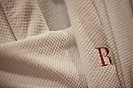 A white robe with a red R at The Redbury Hotel, an SBE property in Hollywood, Los Angeles, CA