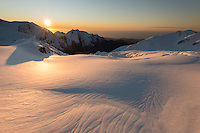 Vast area of Geikie Snowfield of upper parts of Franz Josef Glacier during setting sun with  Tasman Sea on horizon, Westland Tai Poutini National Park, West Coast, UNESCO World Heritage Area, New Zealand, NZ