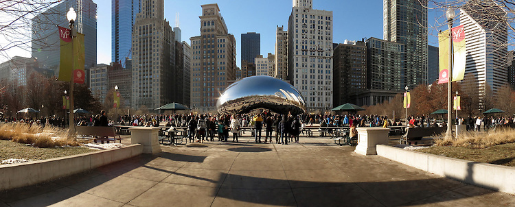Chicago Scenes: Tourists gather in the shadow of the &quot;Cloud Gate&quot; sculpture, a.k.a. &quot;The Bean&quot; at the AT&amp;T Plaza at Millennium Park <br /> <br /> (Optional Trim: Cloud Gate is British artist Anish Kapoor's first public outdoor work installed in the United States. <br /> <br /> The 110-ton elliptical sculpture is forged of a seamless series of highly polished stainless steel plates, which reflect Chicago&rsquo;s famous skyline and the clouds above. A 12-foot-high arch provides a &quot;gate&quot; to the concave chamber beneath the sculpture, inviting visitors to touch its mirror-like surface and see their image reflected back from a variety of perspectives. <br /> <br /> Inspired by liquid mercury, the sculpture is among the largest of its kind in the world, measuring 66-feet long by 33-feet high. )   (DePaul University/Jamie Moncrief)