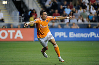 Geoff Cameron (20) of the Houston Dynamo celebrates scoring the game tying goal. The Philadelphia Union and the Houston Dynamo played to a 1-1 tie during a Major League Soccer (MLS) match at PPL Park in Chester, PA, on August 6, 2011.