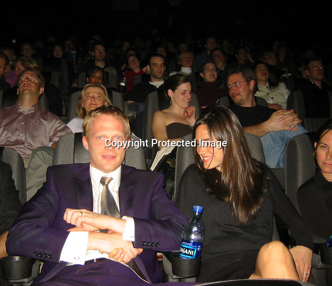 "**EXCLUSIVE**.Jennifer Connelly & husband Paul Bettany inside the Movie Theater with friends and Director Thaddeus O'Sullivan for a special screening of his latest Movie ""The Heart Of Me,"" as part of the TriBeCa Film Festival..2003 Tribeca Film Festival .Battery Park City, NY, USA.Friday, May 09, 2003 .Photo By Celebrityvibe.com/Photovibe.com"