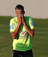 Neymar of Brazil shows a look of dejection during training ahead of tomorrow's World Cup quarter final vs Colombia tomorrow