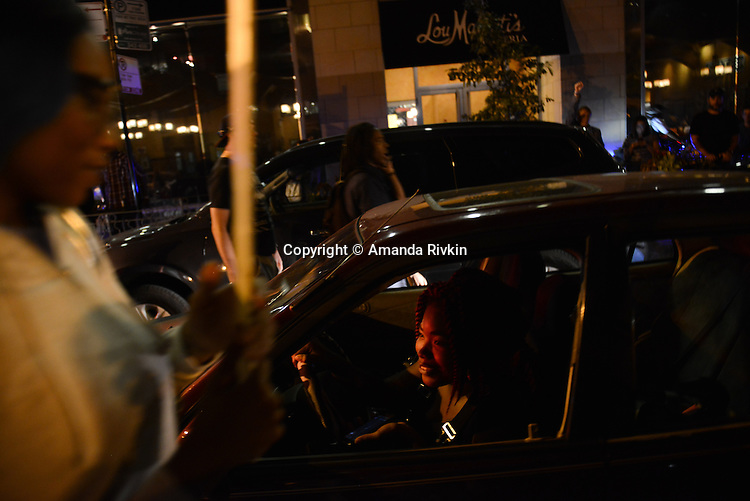 Motorists honked, cheered and threw up fists in support of Black Lives Matter protesters who blocked traffic as they marched through the South Loop in Chicago, Illinois on July 9, 2016.  Protests erupted nationwide following the police shootings of Alton Sterling who was selling bootleg DVDs outside a convenience store in Baton Rouge, Louisiana and Philando Castile during a routine traffic stop for a broken tail light in the St. Paul, Minneapolis suburb of Falcon Heights; on Thursday night, a lone gunman Micah Johnson fired and killed five police officers and injured several others during a Black Lives Matter protest in Dallas.
