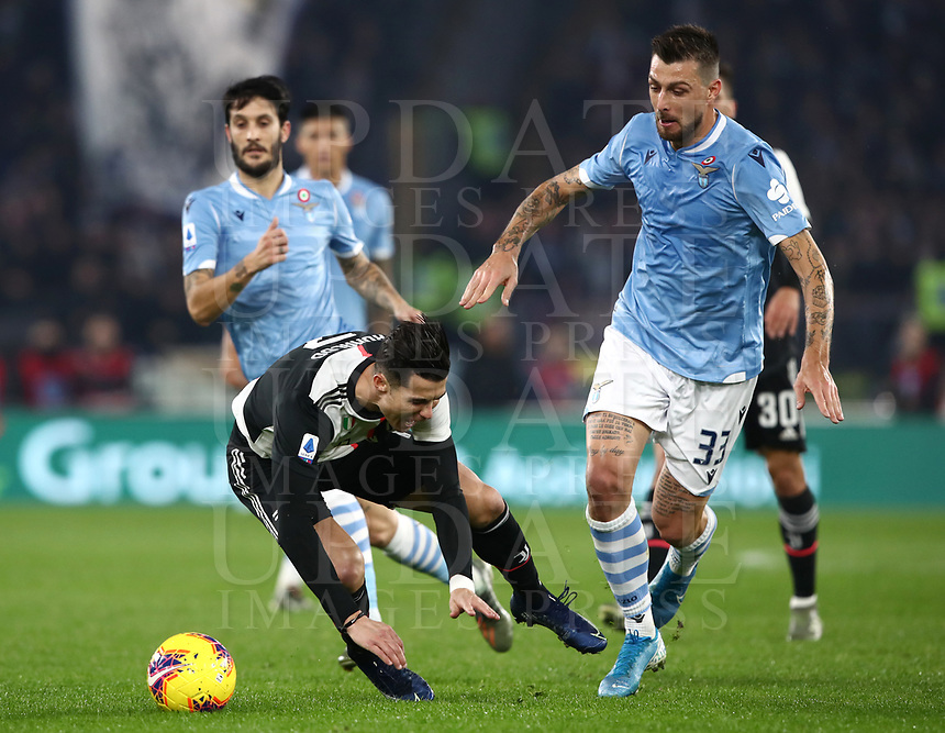Football, Serie A: S.S. Lazio - Juventus Olympic stadium, Rome, December 7, 2019. <br /> Juventus' Cristiano Ronaldo (l) in action with Lazio's Francesco Acerbi (r) during the Italian Serie A football match between S.S. Lazio and Juventus at Rome's Olympic stadium, Rome on December 7, 2019.<br /> UPDATE IMAGES PRESS/Isabella Bonotto