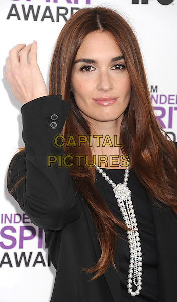 Paz Vega.The 2012 Film Independent Spirit Awards at Santa Monica Pier in Santa Monica, California, USA..February 25, 2012.half length black dress blazer pearl necklace  hand arm.CAP/ROT/TM.©Tony Michaels/Roth Stock/Capital Pictures
