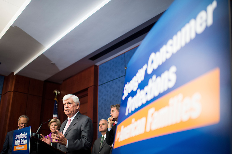 UNITED STATES - JULY 21: Former Sen. Chris Dodd, D-Conn., speaks during the Senate Democrats' news conference to highlight the fifth anniversary of Dodd-Frank financial reform legislation on Tuesday, July 21, 2015. Behind Dodd are Sens. Schumer, Warren, Reed and Brown. (Photo By Bill Clark/CQ Roll Call)