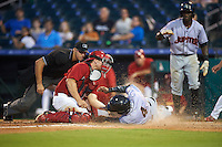 Palm Beach Cardinals catcher Steve Bean (11) attempts to tag Junior Sosa (4) sliding into home safely as umpire Justin Robinson looks on to make the call during a game against the Jupiter Hammerheads  on August 12, 2016 at Roger Dean Stadium in Jupiter, Florida.  Jupiter defeated Palm Beach 9-0.  Jeremias Pinda is to the right.  (Mike Janes/Four Seam Images)