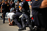 Police officers arrest one person while protesters of the Occupy Wall Street movement celebrate their first anniversary with marches and confrontations with the New York police where 150 protesters have been arrested during weekend celebrations in Manhattan.  Photo by Eduardo Munoz Alvarez / VIEWpress.