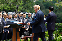 United States President Donald J. Trump and Prime Minister of Japan Shinzo Abe hold a joint news conference in the Rose Garden of the White House after their meeting on June 7, 2018 in Washington, DC.<br /> <br /> CAP/MPI/RS<br /> &copy;RS/MPI/Capital Pictures