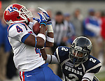 Louisiana Tech receiver Quinton Patton (4) makes a catch against Nevada defender Malik James (2) during the fourth quarter of an NCAA football game Saturday, Nov. 19, 2011, in Reno, Nev. Louisiana Tech won 24-20. (AP Photo/Cathleen Allison)