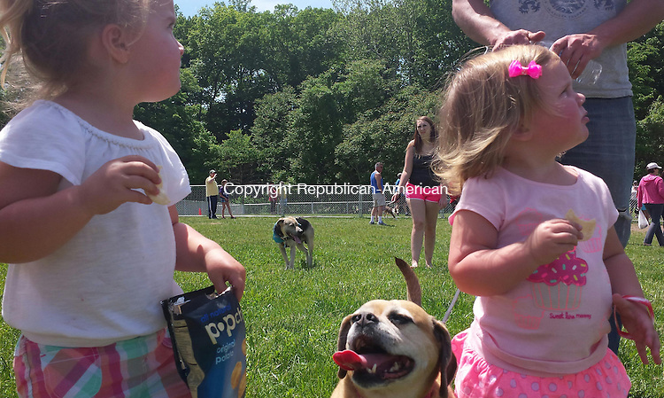 CHESHIRE, CT -  June 1, 2014 - 06012014LX01 - Grace, 2 and Lillian, 1 snak on chips while their dog Winnie looks on during A Cheshire Dog Park Dedication on Sunday.