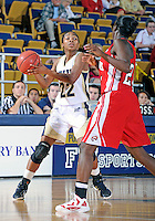 Florida International University guard Jerica Coley (22) plays against Western Kentucky University.  FIU won the game 60-56 on January 28, 2012 at Miami, Florida. .